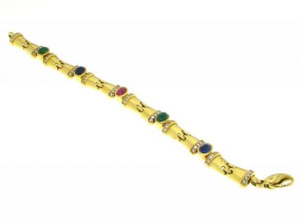 Armband mit Rubin, Safiren und Smaragden
