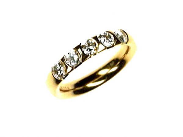 Memoire Ring aus Gelbgold 5 Brillanten